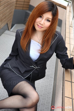 Asian female Yuria Kanno with red hair got excited and went out in sexy clothes
