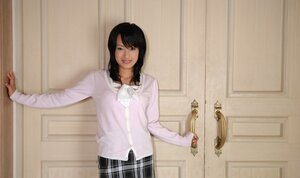 Babe from Japan doesn't hurry to show what she hides under checkered skirt