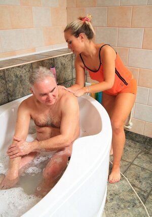 Bimbo blonde seduces mature man in bathroom to taste his prick inside oozy cunny