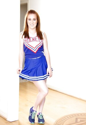 Pale-skinned gal bought sexy cheerleader uniform for hot striptease