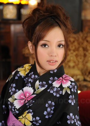 Good-tempered porn model from Japan poses on camera dressed in lovely kimono