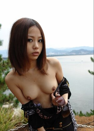 Oriental kitten with sunglasses on looks so seriously cos she is shy being naked