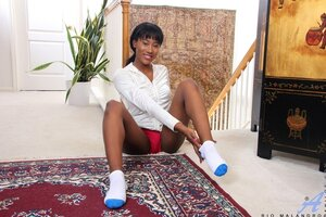 Ebony woman in a black jacket with zipper spreads legs and fingers her cherry