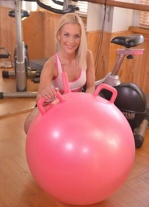 Blonde sportsgirl has a limited fitball with vibrator to train her fuck hole hard