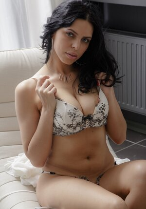 Russian adult star Kira Queen with black hair and plus complete lips uses a little vibrator