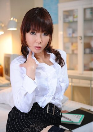 Oriental office appreciate in stockings opens blouse showing off her tender breasts