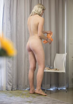Come-hither blonde slut wears orange panties and blue bra under the outfit