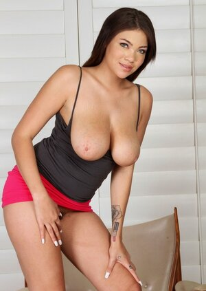 Ebony 18-19 y.o. in a short dress takes breasts and besides additionally butt out and besides additionally puts fingers in cunt