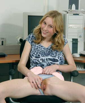 Lascivious worker undresses in office exposing giant bra buddies and trimmed twat
