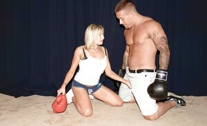 Gorgeous blonde surprises muscular sparring partner with well-done blowjobs