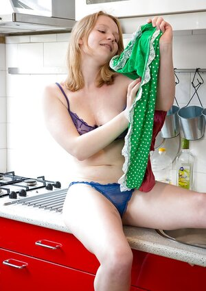 Glamorous kitten comes to the kitchen not to cook but to show pale nude body
